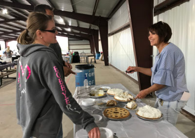 Sherri, Board Member, Serving Trapper Pies