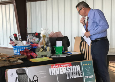 Tim Livingston Reviewing Auction Items
