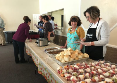 Charlotte and board members getting lunch line ready